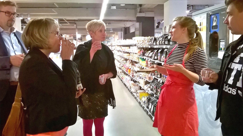 A group of Finnish Free from food producers on a study tour in a Dutch organic food supermarket.